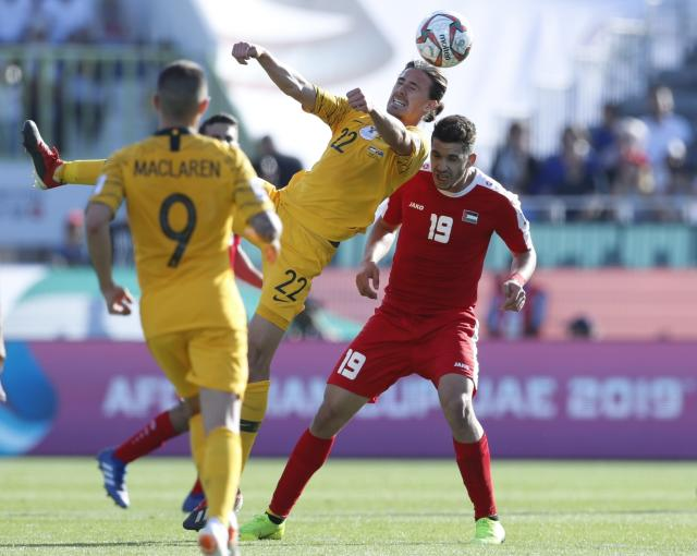 Australia's midfielder Jackson Irvine and Palestine's forward Mahmoud Wadi, right, vie for the ball during the AFC Asian Cup group B soccer match between Australia and Palestine at Al Maktoum Stadium in Dubai, United Arab Emirates, Friday, Jan. 11, 2019. (AP Photo/Hassan Ammar)