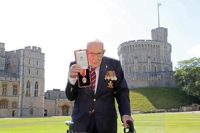 Sir Tom holding the insignia of his knighthood. Chris Jackson/PA Wire