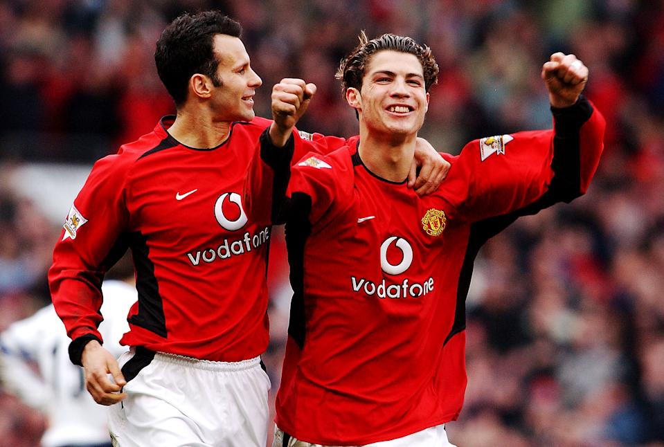 MANCHESTER, ENGLAND - MARCH 20: Cristiano Ronaldo of Manchester United celebrates scoring the second goal with team-mate Ryan Giggs during the FA Barclaycard Premiership match between Manchester United and Tottenham Hotspur at Old Trafford on March 20, 2004 in Manchester, England. (Photo by John Peters/Manchester United via Getty Images)