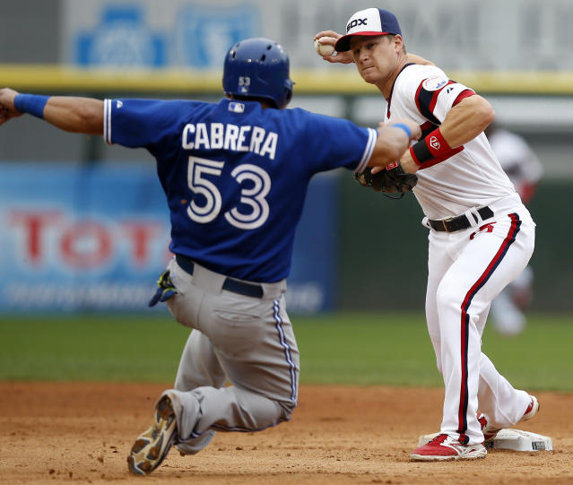 Chicago White Sox second baseman Gordon Beckham, right, forces out Toronto Blue Jays' Melky Cabrera on a double play hit by Jose Bautista during the fifth inning of a baseball game on Sunday, Aug. 17, 2014, in Chicago, Ill. (AP Photo/Andrew A. Nelles)
