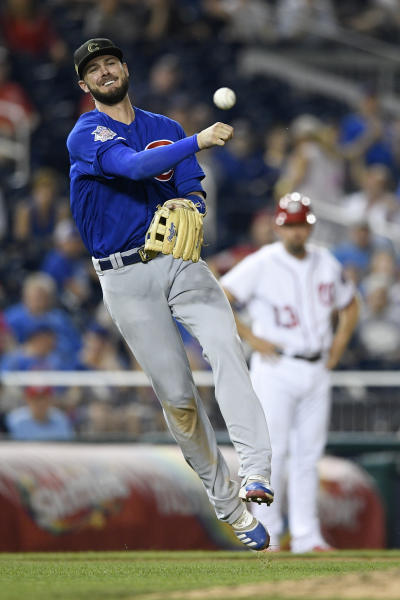 Chicago Cubs third baseman Kris Bryant throws to first to get out Washington Nationals' Howie Kendrick during the ninth inning of a baseball game, Sunday, May 19, 2019, in Washington. The Cubs won 6-5. (AP Photo/Nick Wass)