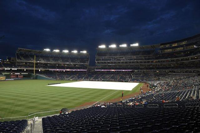The tarp lies on the field during a delay before a baseball game between the Washington Nationals and the Atlanta Braves, Thursday, July 6, 2017, in Washington. (AP Photo)