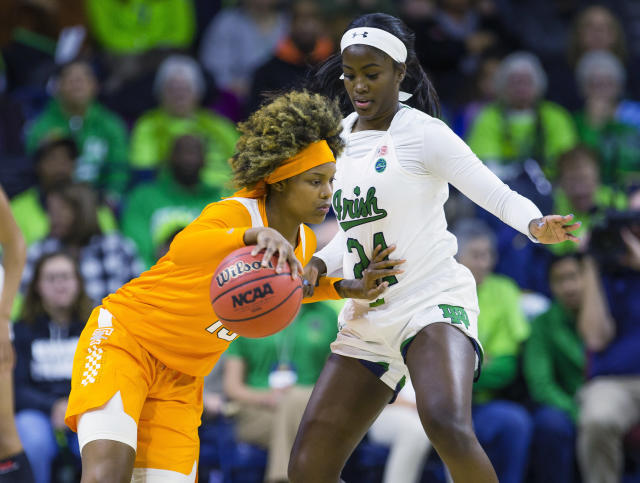 Tennessee's Jazmine Massengill (13) tries to get past Notre Dame's Destinee Walker (24) during an NCAA college basketball game Monday, Nov. 11, 2019 at Purcell Pavilion in South Bend, Ind. (Michael Caterina/South Bend Tribune via AP)