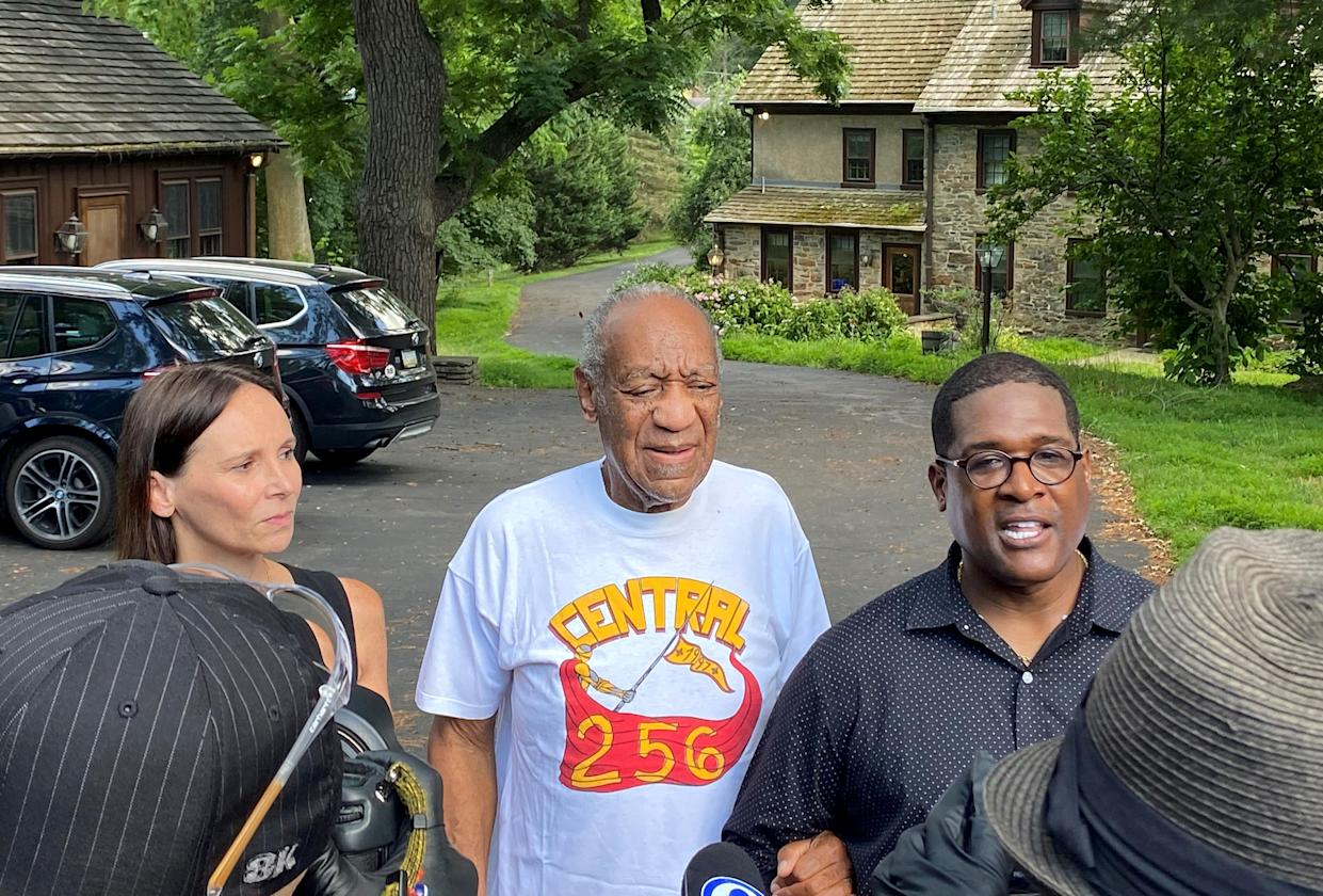 Attorney Jennifer Bonjean, Bill Cosby, and spokesperson Andrew Wyatt speak outside of Bill Cosby's home on June 30 in Cheltenham, Pa. Cosby was released from prison after a court overturned his sex assault conviction. (Photo: Michael Abbott/Getty Images)