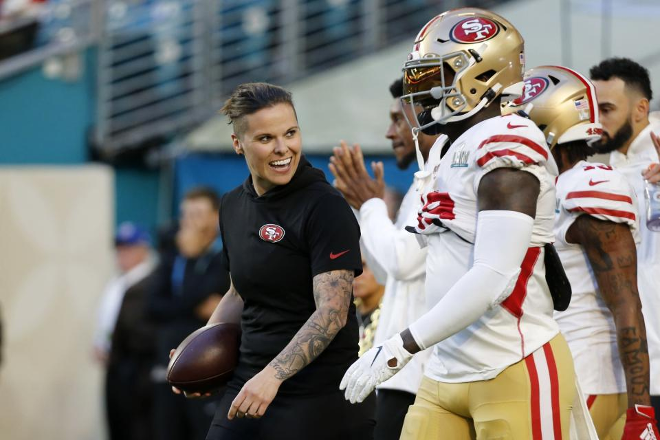 San Francisco 49ers offensive assistant Katie Sowers talks with players before the NFL Super Bowl 54 football game between the San Francisco 49ers and Kansas City Chiefs Sunday, Feb. 2, 2020, in Miami Gardens, Fla. (AP Photo/Mark Humphrey)