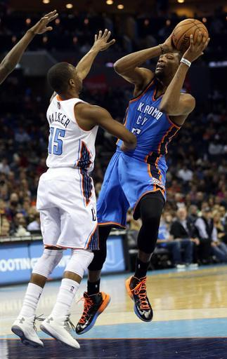CHARLOTTE, NC - MARCH 08: Kevin Durant #35 of the Oklahoma City Thunder looks to pass around Kemba Walker #15 of the Charlotte Bobcats during their game at Time Warner Cable Arena on March 8, 2013 in Charlotte, North Carolina. (Photo by Streeter Lecka/Getty Images)