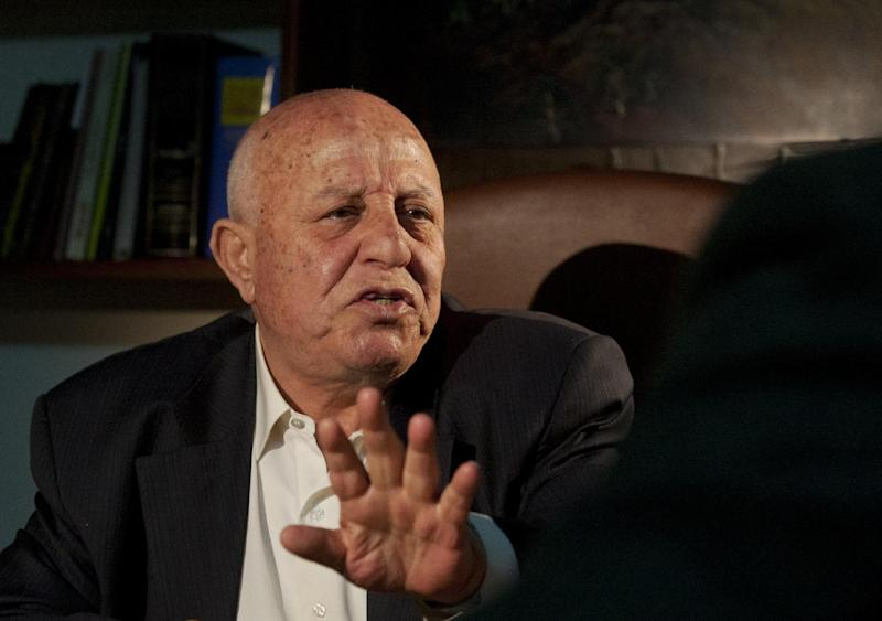 """Former Palestinian Prime Minister Ahmed Qureia gestures as he speaks during an interview with the Associated Press in his office in Abu Dis, near Jerusalem, Monday, April 23, 2012. With gloom deepening over the prospects for peace, Qureia a leading Palestinian figure is suggesting the Palestinians might drop the """"two-state solution"""" that underpinned two decades of wrangling _ and instead seek to replace Israel with a multi-ethnic state covering all of historic Palestine. (AP Photo/Sebastian Scheiner)"""