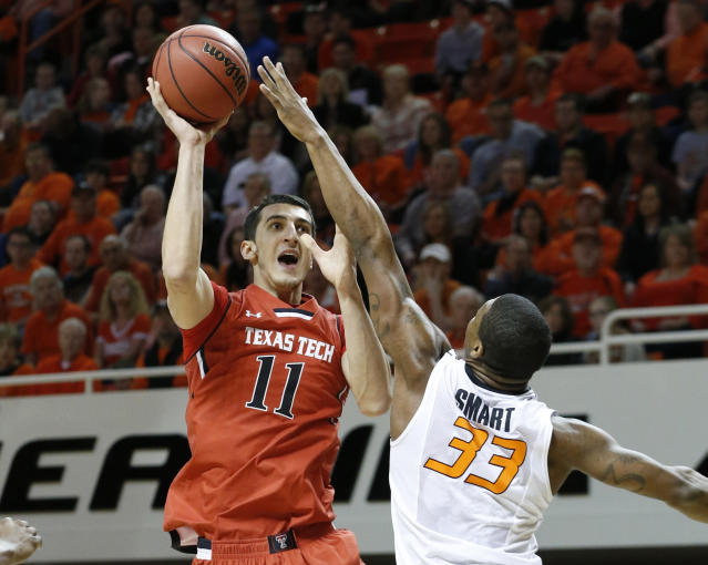 Texas Tech forward Dejan Kravic (11) shoots over Oklahoma State guard Marcus Smart (33) in the first half of an NCAA college basketball game in Stillwater, Okla., Saturday, Feb. 22, 2014. (AP Photo/Sue Ogrocki)