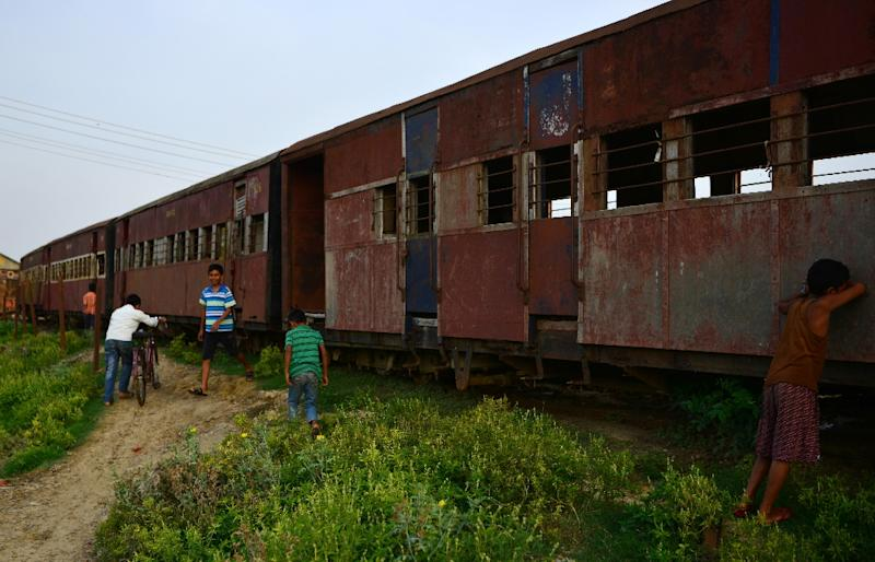 The old railway fell into disrepair after years of neglect and since 2014 the train has sat stationary, its rusting carcass now a playground for local children (AFP Photo/Prakash MATHEMA)