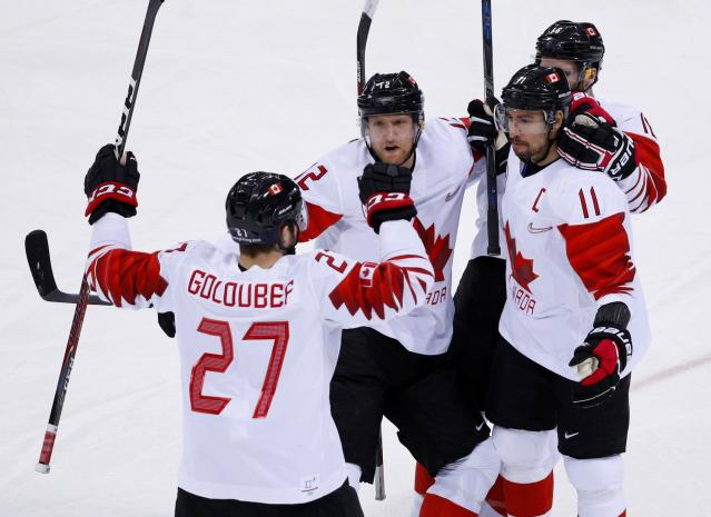 Chris Kelly of Canada celebrates scoring a goal with team mates. (REUTERS/Brian Snyder)