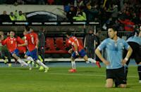 Chile's Mauricio Isla, second left, celebrates with his teammates after scored against Uruguay during a Copa America quarterfinal soccer match at the National Stadium in Santiago, Chile, Wednesday June 24, 2015. (AP Photo/Luis Hidalgo)