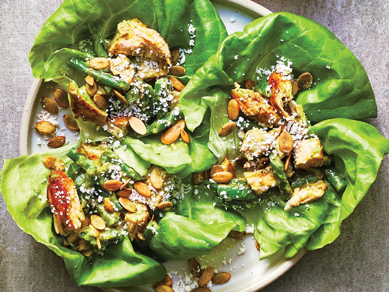 """<p>These fresh lettuce wraps are a cinch to throw together thanks to a smart use of leftovers. Serve them with whatever variety of lettuce leaf you prefer—romaine, iceberg, or green leaf. If you're packing this to take to work, wait until you're ready to eat before filling the leaves, so the lettuce stays crisp. </p> <p> <a href=""""https://www.cookinglight.com/recipes/lemon-garlic-chicken-salad-lettuce-cups"""">View Recipe: Lemon-Garlic Chicken Salad Lettuce Cups</a></p>"""