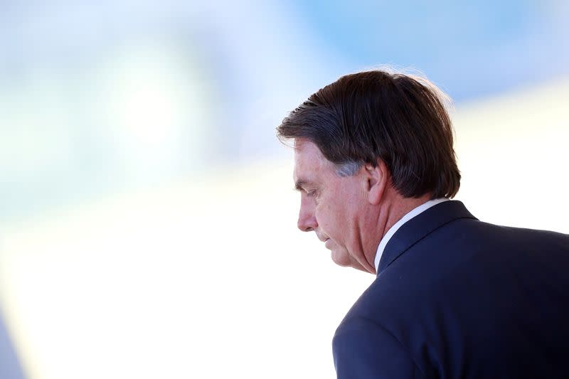 FILE PHOTO: Brazil's President Jair Bolsonaro looks on as he leaves the Alvorada Palace, amid coronavirus disease (COVID-19) outbreak, in Brasilia