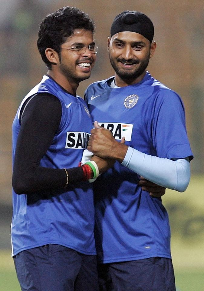 Indian cricketers Harbhajan Singh (R) and Shanthakumaran Sreesanth (L) share a light moment during a training session at the Captain Roop Singh Stadium in Gwalior, 14 November 2007.  Fiery Pakistani fast bowler Shoaib Akhtar admitted he was not in shape for the ongoing series against India, despite impressive recent performances. Pakistan trail 2-1 in the five-match series with the fourth game to be played in Gwalior 15 November.      AFP PHOTO/ MANAN VATSYAYANA