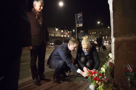 Nicolai Wammen, Danish Minister of Defence, lights a candle in front of the French Embassy in Copenhagen, January 7, 2015, following a shooting by gunmen at the offices of weekly satirical magazine Charlie Hebdo in Paris. REUTERS/Erik Refner/Scanpix Denmark