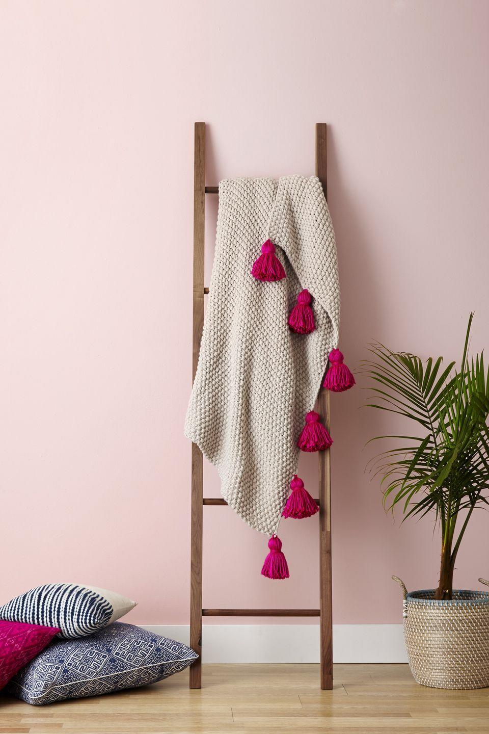 """<p>Because your living room isn't complete unless it has at least three fuzzy throws. Before putting this wooden ladder on display, dress up a plain blanket by creating extra-large tassels and pom-poms from thick yarn and knotting them onto the end. </p><p><a class=""""link rapid-noclick-resp"""" href=""""https://www.amazon.com/Hallops-Blanket-Premium-Decorative-Blankets/dp/B07VP2X9KR/?tag=syn-yahoo-20&ascsubtag=%5Bartid%7C10055.g.1711%5Bsrc%7Cyahoo-us"""" rel=""""nofollow noopener"""" target=""""_blank"""" data-ylk=""""slk:SHOP BLANKET LADDERS"""">SHOP BLANKET LADDERS</a></p>"""