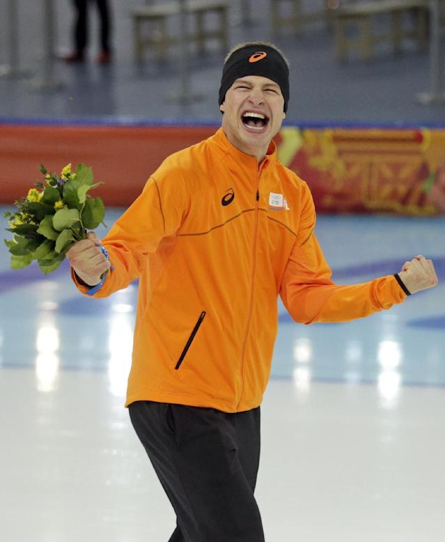Sven Kramer of the Netherlands celebrates after winning the gold in the men's 5,000-meter speedskating race at the Adler Arena Skating Center at the 2014 Winter Olympics in Sochi, Russia, Saturday, Feb. 8, 2014. (AP Photo/Matt Dunham)