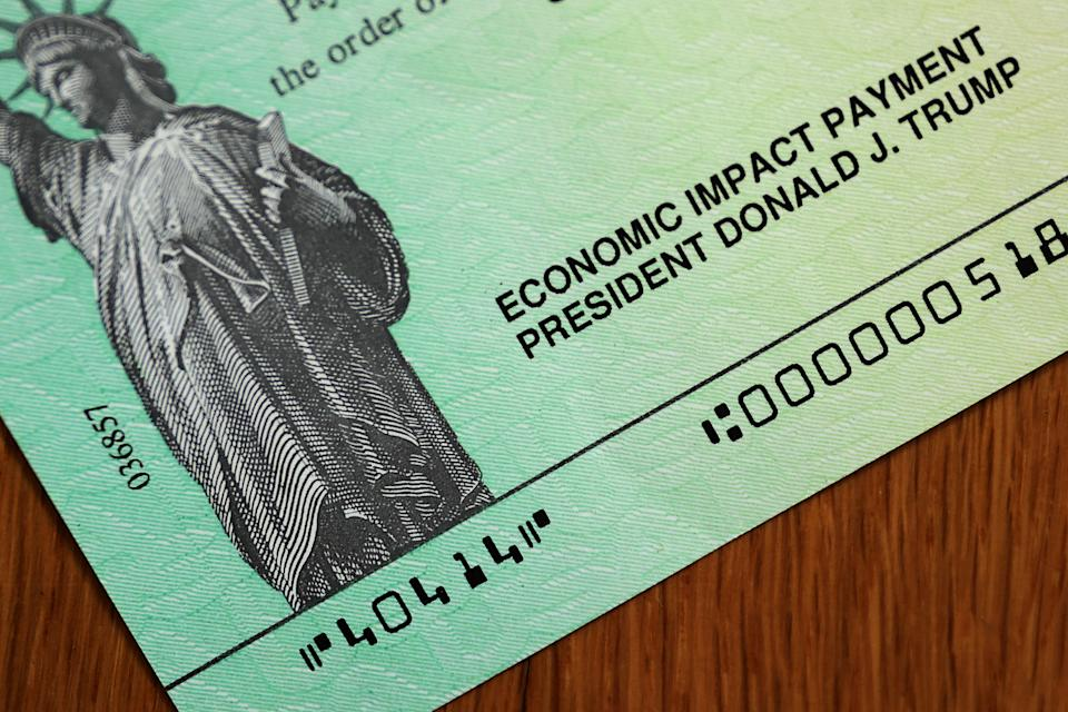 Donald Trump's name appears on the coronavirus economic assistance checks that were sent to citizens across the country on April 29, 2020, in Washington, DC. (Photo by Chip Somodevilla/Getty Images)
