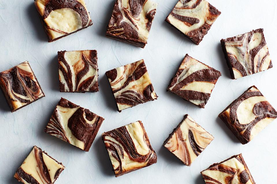 """Everyone's favorite bake sale treat goes gluten-free without any hard-to-find ingredients or alternative flours, just cornstarch and cocoa powder. <a href=""""https://www.epicurious.com/recipes/food/views/fudgy-gluten-free-cream-cheese-brownies?mbid=synd_yahoo_rss"""" rel=""""nofollow noopener"""" target=""""_blank"""" data-ylk=""""slk:See recipe."""" class=""""link rapid-noclick-resp"""">See recipe.</a>"""