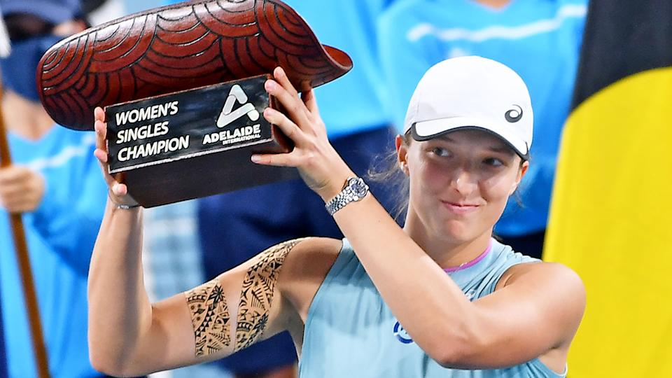Pictured here, Iga Swiatek poses with the Adelaide International trophy.