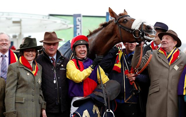Horse Racing - Cheltenham Festival - Cheltenham Racecourse, Cheltenham, Britain - March 16, 2018 Richard Johnson on Native River celebrates with the team after winning the 15.30 Timico Cheltenham Gold Cup Chase Action Images via Reuters/Andrew Boyers