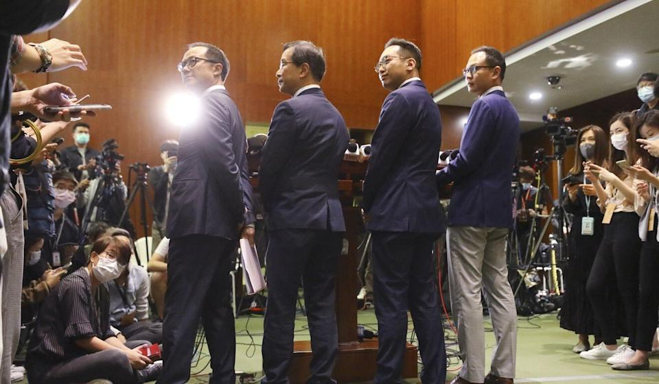 (Left to right) Lawmakers Kenneth Leung, Kwok Ka-ki, Alvin Yeung and Dennis Kwok speak to the press about their ousting on Wednesday. Photo: Dickson Lee