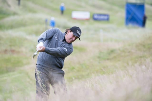 U.S. golfer Phil Mickelson plays from the rough on the 4th hole during day one of the Scottish Open at Royal Aberdeen golf course, Aberdeen Scotland Thursday July 10, 2014. (AP Photo/Kenny Smith/PA)