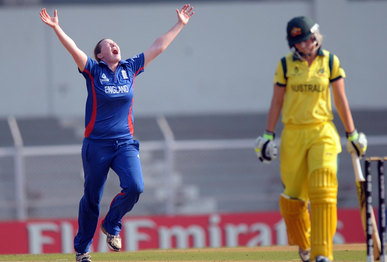 MUMBAI, INDIA - FEBRUARY 08:  Anya Shrubsole of England celebrates the wicket of  Meghann Lanning of Australia during the super six match  between England and Australia held at the CCI (Cricket Club of India)  on February 8, 2013 in Mumbai, India.  (Photo by Pal Pillai/Getty Images)