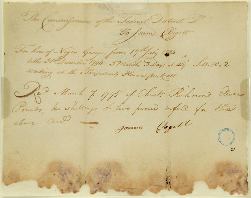 An original copy of a voucher for James Clagett who received payment for work done by a slave named Negro George for five months and three days of work to help build the White House. The document is on display at the National Archives.