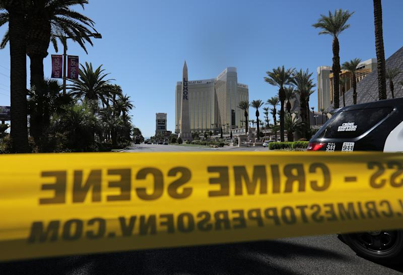 Police crime scene tape marks a perimeter outside the Luxor Las Vegas hotel and the Mandalay Bay Resort and Casino.  (Mike Blake/Reuters)