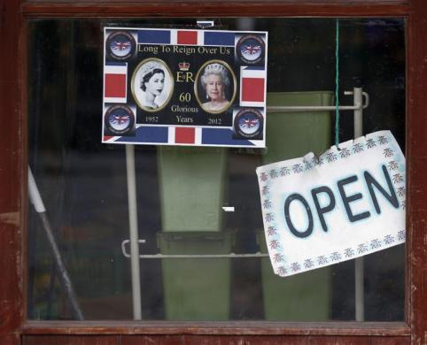 A sign to commemorate the 60th anniversary of the reign of Britain's Queen Elizabeth is seen on a store window in Port Stanley March 15, 2012.