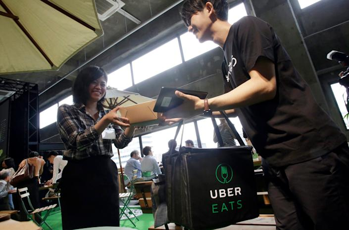 """Services like UberEats can help you support favorite restaurants while staying in. Just wash your hands after the exchange of money and goods. <p class=""""copyright"""">Eugene Hoshiko/AP</p>"""