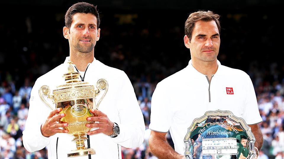 Novak Djokovic (pictured left) smiles has holds the Wimbledon trophy next to runner-up Roger Federer (pictured right).