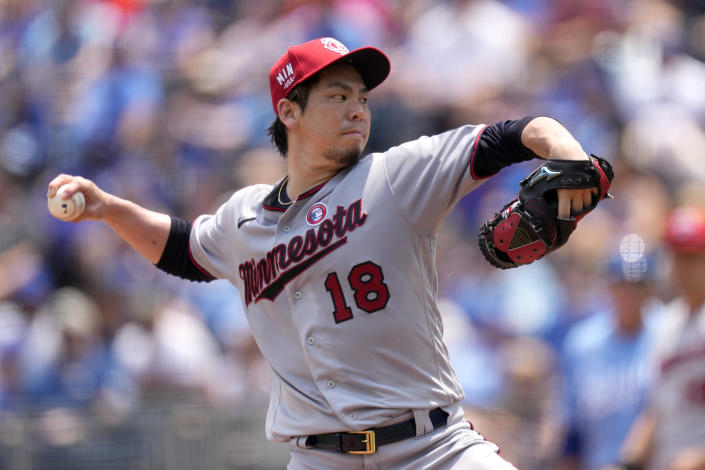 Minnesota Twins starting pitcher Kenta Maeda throws during the first inning of a baseball game against the Kansas City Royals Sunday, July 4, 2021, in Kansas City, Mo. (AP Photo/Charlie Riedel)