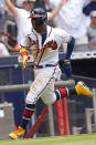 Atlanta Braves/ Ronald Acuna Jr. (13) runs home to score on an Ozzie Albies' base hit in the sixth inning of a baseball game against the Washington Nationals, Thursday, June 3, 2021, in Atlanta. (AP Photo/John Bazemore)