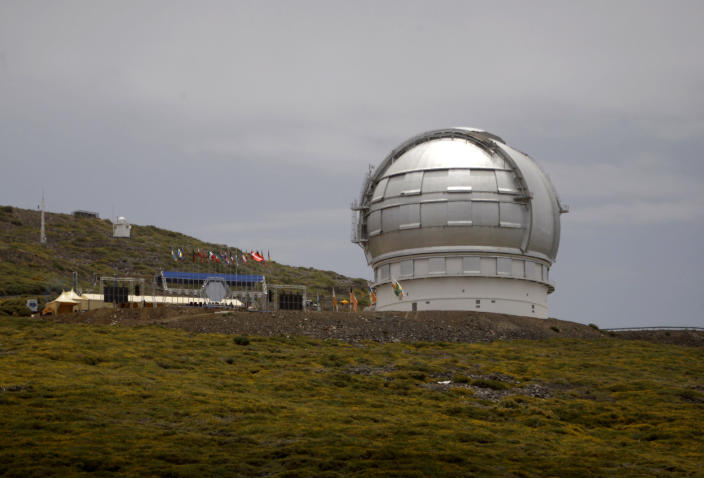 FILE - This July 24, 2009 file photo shows the Gran Telescopio Canarias, one of the the world's largest telescopes, at the Observatorio del Roque de los Muchachos on the Canary Island of La Palma, Spain. A judicial decision from Spain's Canary Islands has put a halt on an alternative plan to build a giant telescope unpopular in Hawaii, which is the preferred location. Construction of the Thirty Meter Telescope on Hawaii's tallest mountain, Mauna Kea, has been stalled by opponents who say the project will desecrate land that's sacred to some Native Hawaiians. If it can't be built in Hawaii, telescope officials have selected the alternate location on the highest mountain of La Palma, a Spanish island off Africa's western coast. But a court there ruled last month in a decision that just emerged that a public concession for the site was invalid. (AP Photo/Carlos Moreno, File)