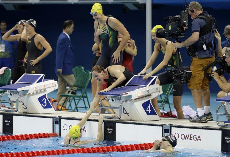The Australian 4x100 freestyle team celebrates after winning Olympic gold on Saturday. (AP)