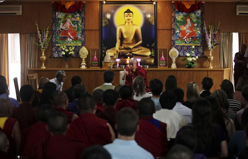 In this June 6, 2012 photo, Tibetan spiritual leader Dalai Lama addresses Emory University faculty members and Tibetan Buddhist monks during a graduation ceremony in Dharamsala, India. In an educational complex perched on the edge of a small river valley, in a place where the Himalayan foothills descend into the Indian plains, this group of Tibetan monks are working with American scientists to tie their ancient culture to the modern world. (AP Photo/Altaf Qadri)