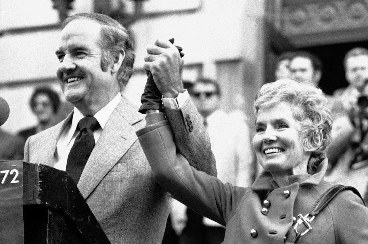 FILE - In this Oct. 31, 1972 file photo, Sen. George McGovern holds up the hand of his wife Eleanor and announced to the crowd gathered in downtown Syracuse that today is their 29th wedding anniversary. A family spokesman says, McGovern, the Democrat who lost to President Richard Nixon in 1972 in a historic landslide, has died at the age of 90. According to the spokesman, McGovern died Sunday, Oct. 21, 2012 at a hospice in Sioux Falls, surrounded by family and friends. (AP Photo/Bob Schutz)