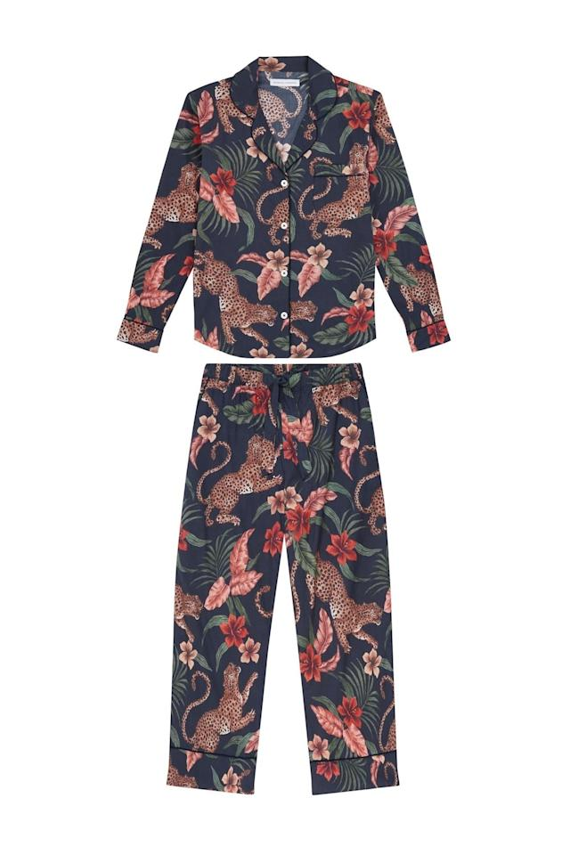 """A beautiful cotton <a href=""""https://www.glamour.com/gallery/best-pajamas-loungewear-shopping?mbid=synd_yahoo_rss"""">pajama set</a>, like the hand-painted ones made by Desmond & Dempsey, is an unexpected yet surprisingly practical gift when dinner and drinks turns into dinner and <a href=""""https://www.glamour.com/about/rom-com-week?mbid=synd_yahoo_rss"""">binge-watching old rom-coms</a>. $180, Bergdorf Goodman. <a href=""""https://www.bergdorfgoodman.com/p/desmond-dempsey-soleia-silk-classic-pajama-set-prod150580065"""">Get it now!</a>"""