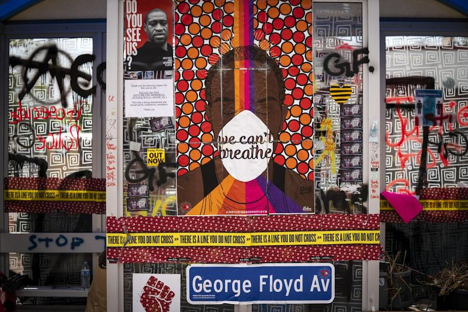 A bus stop in Minneapolis is part of a memorial to George Floyd.