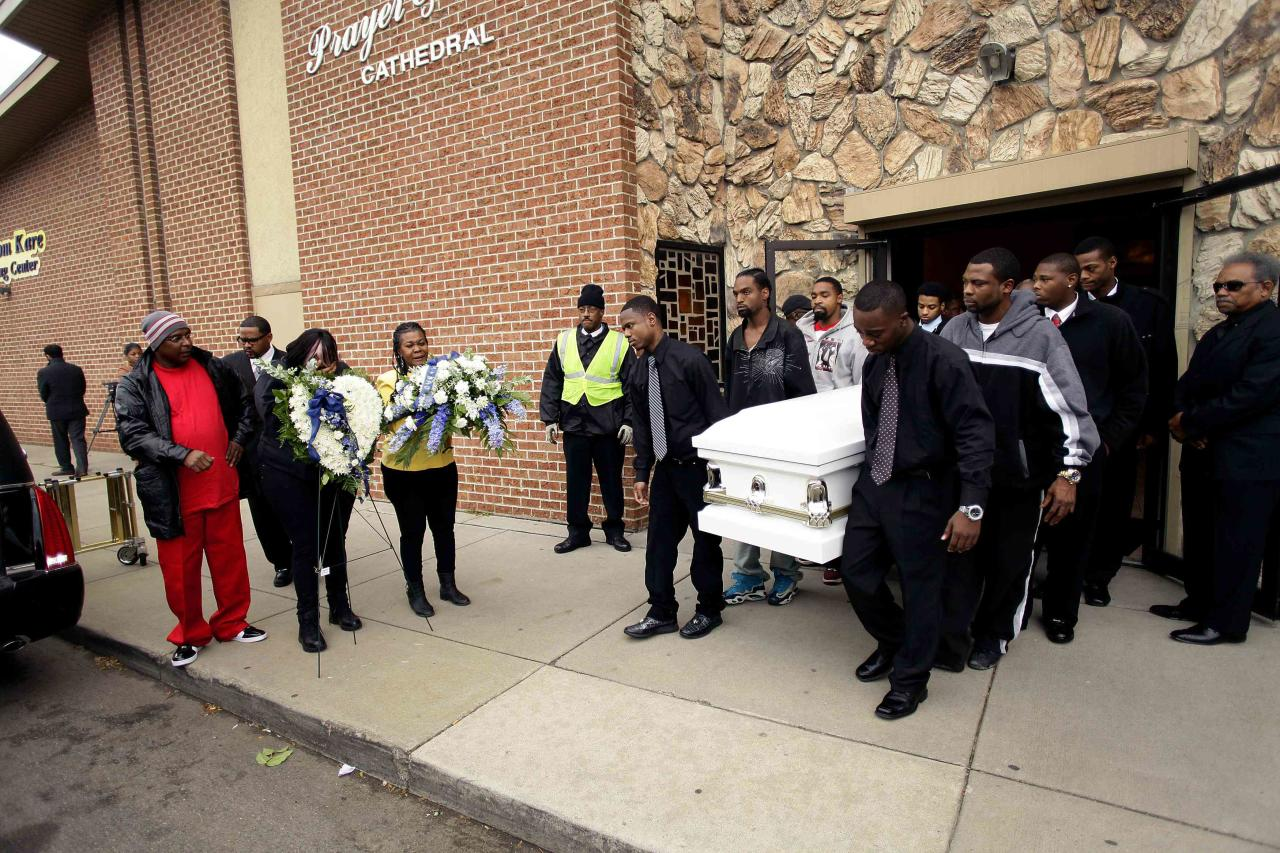 Pallbearers carry the casket for 19-year-old shooting victim Renisha McBride during her funeral service in Detroit, Michigan November 8, 2013. McBride was shot dead on November 2 at a home where she sought help after a car accident in Dearborn Heights, Michigan. REUTERS/Joshua Lott (UNITED STATES - Tags: CRIME LAW)