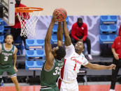 Houston guard Jamal Shead (1) attempts to block a shot by Cleveland State forward Deante Johnson (35) during the first half of a first-round game in the NCAA men's college basketball tournament, Friday, March 19, 2021, at Assembly Hall in Bloomington, Ind. (AP Photo/Doug McSchooler)