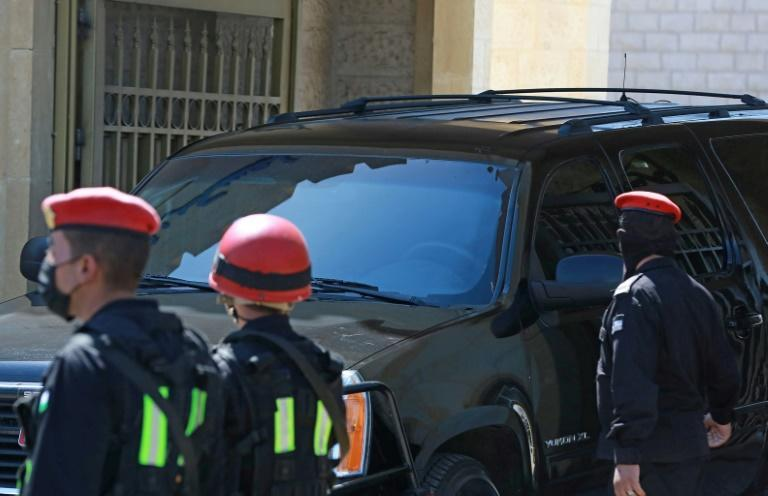 A vehicle with tinted windows leaves the State Security Court in Amman, where two ex-officials accused of plotting a palace coup have been on trial