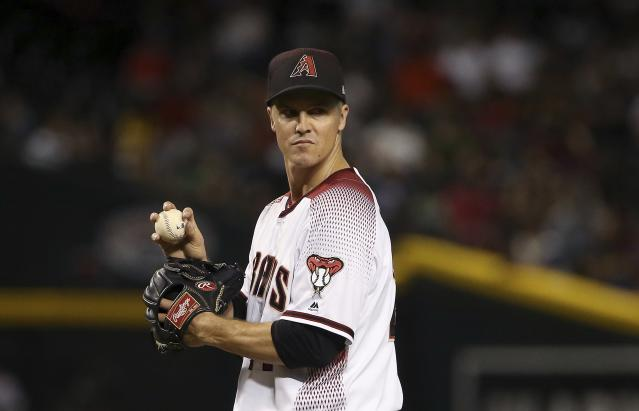 Arizona Diamondbacks starting pitcher Zack Greinke pauses on the mound after giving up a two-run double to Colorado Rockies' Ryan McMahon during the seventh inning of a baseball game Wednesday, June 19, 2019, in Phoenix. (AP Photo/Ross D. Franklin)