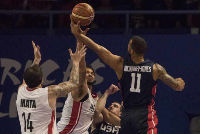 U.S. player Trey McKinney, right, fights for the ball with Mexico's Orlando Mendez, center, and Lorenzo Mata during the first quarter of a regular season FIBA basketball World Cup qualifier in Mexico City, Thursday, June 28, 2018. (AP Photo/Christian Palma)
