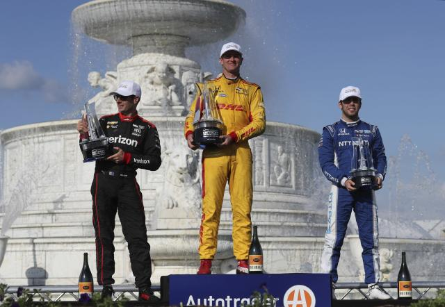 Winner Ryan Hunter-Reay, center, second place finisher Will Power, left, and Ed Jones pose with their trophies after the second race of the IndyCar Detroit Grand Prix auto racing doubleheader, Sunday, June 3, 2018, in Detroit. (AP Photo/Carlos Osorio)