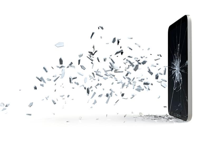 Broken glass shards fly from a shattered smartphone screen
