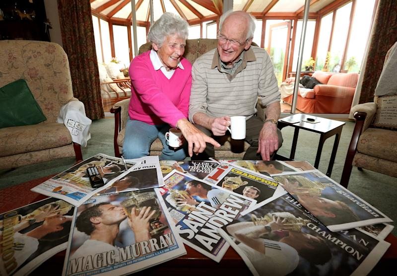 Shirley and Roy Erskine, grandparents of Andy Murray, pose with the morning newspapers Monday July 8, 2013 at their home in Dunblane, Scotland after their grandson's Wimbledon victory on Centre Court on Sunday. Murray ended Britain's 77-year wait for a Wimbledon men's singles tennis champion with a 6-4 7-5 6-4 victory over Novak Djokovic. (AP Photo/Andrew Milligan, PA) UNITED KINGDOM OUT - NO SALES - NO ARCHIVES