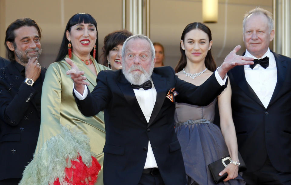 """71st Cannes Film Festival - Closing ceremony and screening of the film """"The Man Who Killed Don Quixote"""" out of competition - Red Carpet Arrivals - Cannes, France, May 19, 2018 - Director Terry Gilliam gestures as cast members Jordi Molla, Rossy De Palma, Olga Kurylenko and Stellan Skarsgard look on. REUTERS/Jean-Paul Pelissier"""